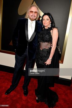 Musician Barry Gibb (L) and Linda Gibb attend The 57th Annual GRAMMY Awards at…