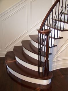 Staircases & Bannister Millwork [GALLERY] Gorgeous wrought iron balluster stairs with painted treads and risers Wrought Iron Stair Railing, Stair Railing Design, Staircase Railings, Curved Staircase, Banisters, Railing Ideas, Staircases, Staircase Remodel, Staircase Makeover