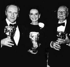 Audrey Hepburn between Sir Anthony Hopkins and Sir John Gielgud at the Bafta Awards in 1992.