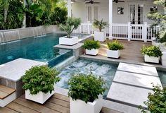 Comfort Semi Inground Pools Incomparable To Fill Your Leisure Time: Semi Inground Pools In Beach Style Pool With Flagstone Walkway And Wood Fence Designs Also Palm Trees And Pool Fountain Plus Potted Plants And Waterfall ~ franklester.com Architecture Inspiration