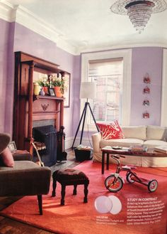 Lavender living room with red rug and wood accents
