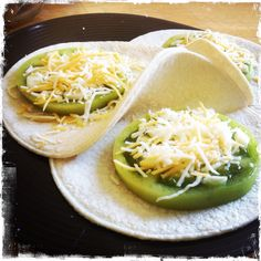 Fresh green tomatoes with triple cheese on corn tortilla.