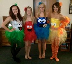 Group Halloween Sesame Street Costumes! DIY: duct tape tops (saran wrap torso then duct tape over top) and homemade tutus! The eyes and other features on the tops are cut out of felt. Easy and cheap! :)