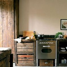 I think this is the prettiest kitchen - just goes to show that granite, new cabinets, and large spaces aren't always where it's at.  Freaking love those reclaimed drawers.