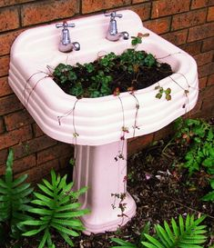 filled with potting mix and planted with ornamental strawberries - come spring this wash stand will be draped with new foliage and brimming with bright red berries. 071008aus-jenny01.jpg