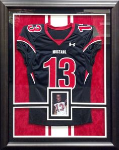 This football jersey is mounted on inlaid mats and is completely reversible. Our custom framing departments can mount jerseys and other sports memorabilia with industry approved methods.