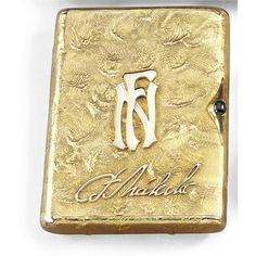 A GOLD SAMODOROK CIGARETTE CASE, ILYA KATORSKY, ST PETERSBURG, 1908-1917 rounded rectangular, the lid applied with gold signature and initials, the interior with Cyrillic presentation inscription dated 1920, cabochon sapphire thumbpiece, 56 standard