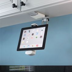 The Under-Cabinet iPad Dock - Hammacher Schlemmer. The iPad dock has an extending, pivoting arm that mounts to the underside of a cabinet or wall.