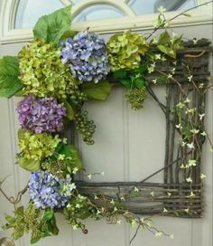 wreath of woven branches accented with hydrangea