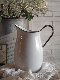 large white enamel pitcher - I could do a lot with this!