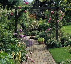 I like this single row rose arbor for the spot in front of the bedroom window.