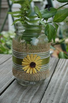 Decorated  Mason Jar with Burlap and green checkered ribbon with bright yellow daisy shabby chic  or country home decor. $7.50, via Etsy.
