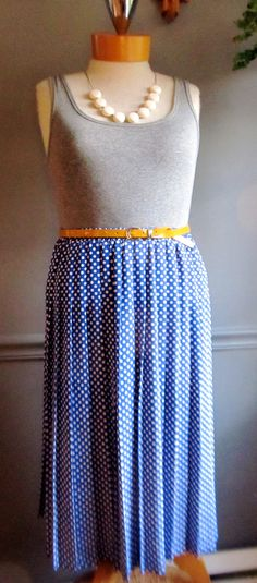 This vintage skirt is royal blue and has an all over tiny white flower print. It has an elastic waistband, accordion pleats, and a Leslie Fay Dresses tag, and fits a women's size Measurements (laying flat): Waist: Length: Hips: Hem: Accordion Skirt, Tiny White Flowers, Vintage Skirt, Flower Prints, Preppy, Royal Blue, Size 16, Blue And White, Chic
