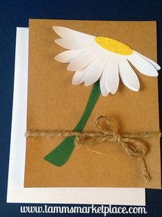 The yellow sparkling center and white petals of this daisy pop off the paper. A piece of jute twine is tied on the bottom forming a cute bow. The card is simple and beautiful. Inside has another daisy Jute Crafts, Sand Crafts, Paper Crafts, Easy Arts And Crafts, Crafts For Kids, Flower Cards, Paper Flowers, Quilling Designs, Jute Twine