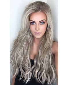 "Chloe Boucher - ""Hair for daaayyss  The extensions I'm wearing are the @foxylocks seamless 24"" clip-ins in Latte blonde. O B S E S S E D!   Use code 'FoxyChloeB' at checkout for a free gift with your purchase   #longhair #blonde #foxylocks #sp  """