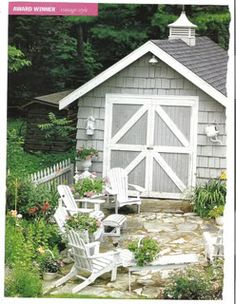 Grey storage shed with white trim. I would like to do something like this for a dog house to match the farm!