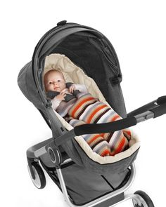 Compact Stokke Scoot Stroller Suitable from birth with cozy  soft sleeping bag.