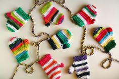 """DIY - Cozy Mitten Garland by Caught On A Whim. Free pattern for """"Mrs. Murdock's Mittens"""" here: http://www.crochetme.com/media/p/109505.aspx. ☀CQ #crochet #christmas"""