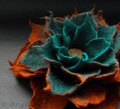 BridgetStudio, hand felted flowfer in teal and rust / copper with glass beads