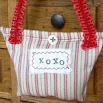 """Turn a fabric scrap into this charmer! Use a bit of trim for the purse handle, fill with dried lavender buds and stamp on a """"designer"""" label."""