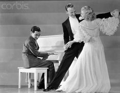 "Irving Berlin playing piano for Fred Astaire and Ginger Rogers.  ""As a dancer he stands alone, and no singer knows his way around a song like Fred Astaire."" Irving Berlin, quoted in Puttin' on the Ritz, BBC Programme Acquisition, 1999."