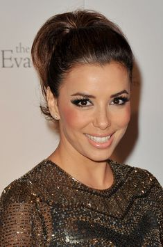 Eva #Longoria- winged liner, bun, beaded dress