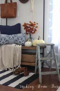 Fall Home Tour - love the navy and white striped rug with rust brown accents!