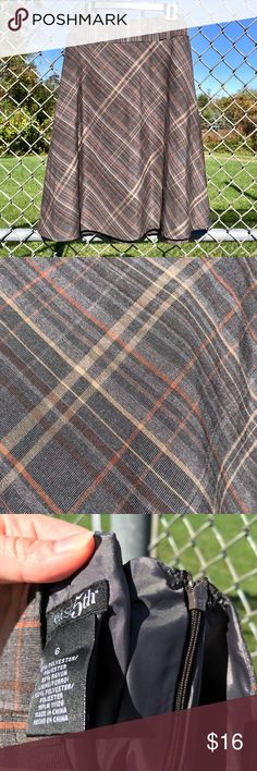 Plaid skirt! This long plaid skirt gives you a super cute vintage look. With colors perfect for the changing seasons, she matches with tons of different tops and shoes, and can be worn throughout the winter.  42SKRT-42SM-WL05 Skirts A-Line or Full