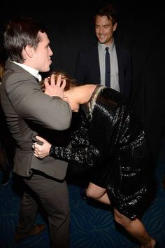 Jennifer Lawrence and Josh Hutcherson backstage at the 2013 People's Choice Awards held at Nokia Theatre L.A. Live on 01/09/12. They're crazy! haha