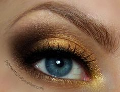 Beautiful bronze tones bring blue eyes to life with Makeup Geek eyeshadow and a hint of Sugarpill's Goldilux. This look is totally on trend for Summer 2012!