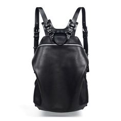 Spiro Black Harness Backpack, zipped main closure. 1 outside zip pocket, 1  inside zip pocket. Adjustable shoulder straps.Hand or back. Handmade in  France.  All items on the TEO+NG site are made to order within 1-2 weeks,depending  on the item.  Color : Black  Material : Cow leather, Veg