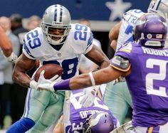 Dallas Cowboys running back DeMarco Murray (29) looks for running room against Minnesota Vikings cornerback Josh Robinson