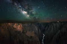 Black Canyon of the Gunnison National Park in Colorado and see some of the steepest cliffs, oldest rock and craggiest spires in North America. Pictured here is a stunning shot of the park at night with the Milky Way rising above the Black Canyon