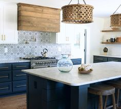 Blue white wood kitchen with patterned tile