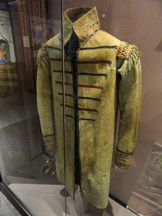 European style coat, Iroquioian or Huron, collected in 1839. Exhibit from the Native American Collection, Peabody Museum, Harvard University, Cambridge, Massachusetts, USA. Photography was permitted without restriction; exhibit is old enough so that it is in the public domain.