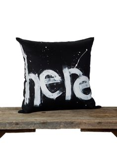 With an edgy, urban aesthetic, and tongue-in-cheek wit, the Graffiti Range of individually hand-painted lamp shades and cushions is guaranteed to lend street cred to your living or working space. Cushion cover is standard size - 45cm x 45cm, and backed with thick black velvet. Insert not included. Every product is individually hand-painted using eco-friendly paint on cotton base cloth, in graphic black and white. Designs are exclusive to Seven Dandelions.