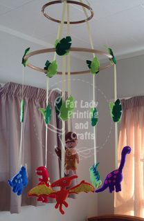 This mobile consists of 2 bamboo rings with a variety of bright Dinosaurs hanging below them, and a fantastic little Caveman suspended in the middle,this creates a bright colourful hanging for your precious little one to gaze at from their cot and adds a nice touch of colour to brighten up the nursery.  Each creature is made from quality wool/acrylic blend felt, and is hand stitched together and stuffed with polyfill, they are strung up with strong ribbon.  This makes them light weight so…