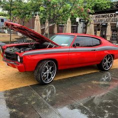 """71 Chevelle on 24"""" asanti wheels this one is definitely going to cause problems in the streets. red grey and black with yenko stripe. painted bumpers. ls3 six speed umi suspension baer brakes"""