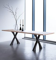 Our Exe dining table - a table for all occasions. With a solid wooden top spanning two elegant steel crosses it's a modern take on an old refectory table, ideal for family life.