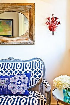 blue and white! love the pairing of fabrics here, and the the blue washed wood frame of the settee