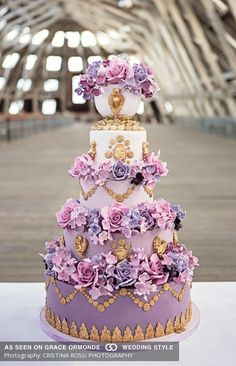 #Purple #ombré cake inspired by #Marie #Antoinette embellished with #gold swags, cherubs, cameos, handcrafted sugar #roses, sugar #hydrangea, #stephanotis and blossoms. #graceormonde #weddingstyle #GOWS #weddingcake #dessert #couture #bride #weddinginspiration #luxuryweddings