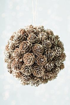 Pretty! Glue pinecones on a styrofoam ball.