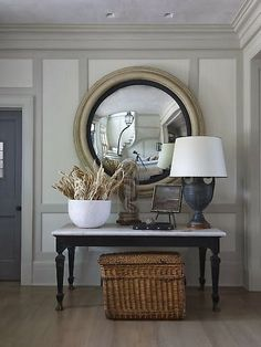 Table and mirror combination, neutral tones of the marble top and wood