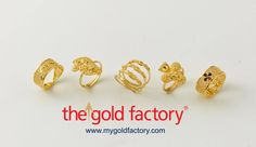 A cluster of chowmein rings in different shapes with the one in the centre the odd one out. That is the ever-popular spiral ring. All in 22K hallmarked gold. Up for grabs at fantastic prices only at The Gold Factory.  #jewellery #gold