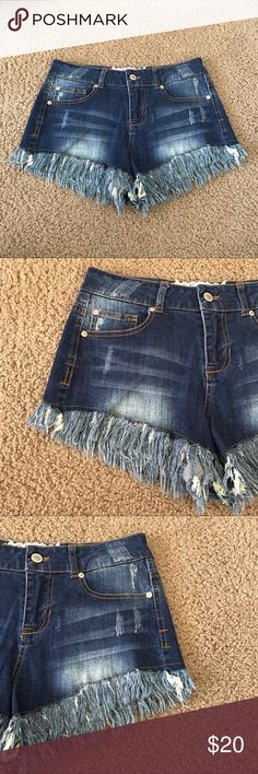 Altar'd State Fringe High Waisted Jean Shorts A gently used dark wash pair of jean shorts by Altar'd State in a size 3/26. In a high rise style it features fringe bottoms. Style#AJ3080ITS  ✨ Ask me about free shipping! 💕 Always ships within 2 business day 🚫 I do not trade Altar'd State Shorts Jean Shorts