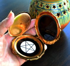 Pentacle scrying mirror in a vintage cosmetic compact. We can now customize our compact scrying mirrors with the graphic of your choice. Cinnabarys