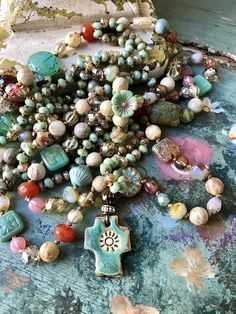 The color of this necklace is just amazing because these little beads actually sparkle! Who would have known? These beads are tiny...3 x 5mm... perfect for this adorable pottery cross pendant. I always like to keep things simple, and this is definitely a simple necklace. But dont let