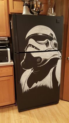 Repainted my old fridge with black chalkboard paint, and got a little carried away! ;)