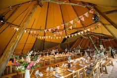 Image by Red On Blonde - A Rustic And Bohemian Tipi Wedding With A 'Dentelle' Jenny Packham Wedding Dress And A White Bouquet With A Mobile Bar