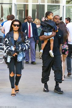 Family time: Kim and Kanye regularly enjoy family outings, with both proving to be hands on parents